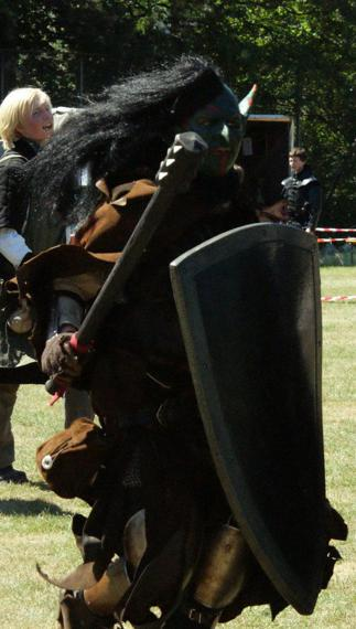 orc_fighting_by_aynaet-d3i4rxh.jpg